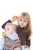 Two little baby eat apples Stock Photo