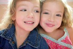 Two little beautiful toddler twin sisters stock image