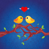 Two little birds in love. Sitting on a branch with fresh green leaves. Grungy background St. Valentine's illustration. Kissing Royalty Free Stock Photo