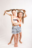 Two little blond girls Stock Images