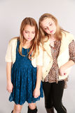 Two little blonde girls looking down Royalty Free Stock Photo