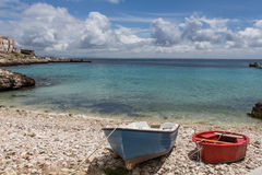 Two little boats. On the cove of a mediterranean island of Levanzo, Sicily, Italy stock images