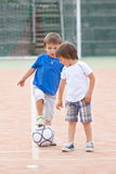 Two little boy, playing football Royalty Free Stock Photo