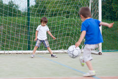 Two little boy, playing football Royalty Free Stock Image