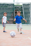 Two little boy, playing football Royalty Free Stock Photography