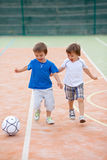 Two little boy, playing football Stock Photography
