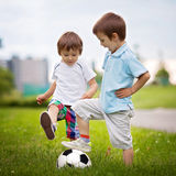 Two little boy, playing football Royalty Free Stock Images
