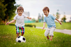 Two little boy, playing football Stock Image
