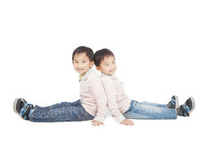 Two little boy sitting on the floor. Isolated on white Stock Images