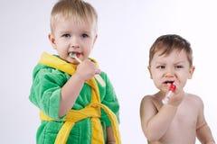 Two little boys brushing teeth Royalty Free Stock Photo