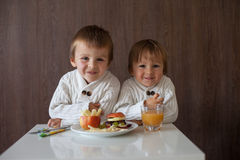 Two little boys, eating fruit sanwich Royalty Free Stock Photo