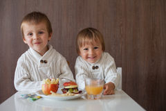 Two little boys, eating fruit sanwich Royalty Free Stock Photos