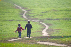 Two little boys following the path Stock Photo