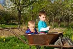Two little boys  in the garden. Royalty Free Stock Images