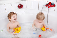 Two little boys  having fun in bathtub Stock Photography