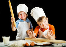 Two little boys making pizza or pasta dough Stock Photo