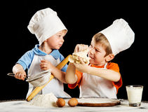 Two little boys making pizza or pasta dough Royalty Free Stock Photography