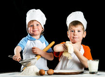 Two little boys making pizza or pasta dough Royalty Free Stock Photo
