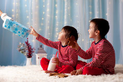 Two little boys in pajamas, waiting from Santa Claus, Santa brin Royalty Free Stock Photography