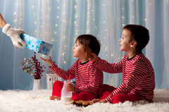 Two little boys in pajamas, waiting from Santa Claus, Santa brin Stock Photography