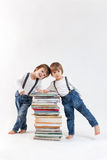 Two little boys with a pile of books Stock Image