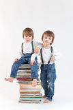 Two little boys with a pile of books Royalty Free Stock Photo
