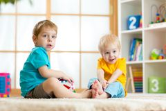 Two little boys play together with educational Royalty Free Stock Photo