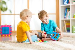 Two little boys play together with educational Stock Image