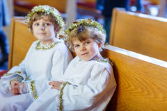 Two little boys playing an angel of Christmas story in church Royalty Free Stock Photography
