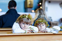 Two little boys playing an angel of Christmas story in church Royalty Free Stock Photo