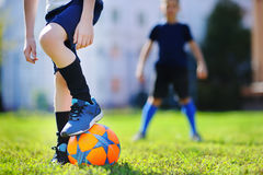 Two little boys playing a soccer game Royalty Free Stock Photo