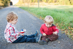 Two little boys playing, on  summer landscap Royalty Free Stock Photos