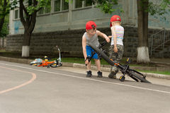 Two little boys playing with their bicycles Royalty Free Stock Image