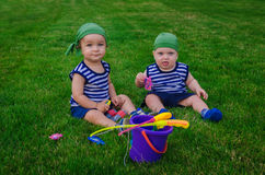 Two little boys playing in the toddlers fishermen sitting on fre Royalty Free Stock Photos