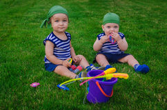 Two little boys playing in the toddlers fishermen sitting on fre Royalty Free Stock Photo