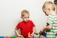 Two little boys playing with toys having fun Royalty Free Stock Photo