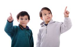 Two little boys pressing digital buttons Stock Photos