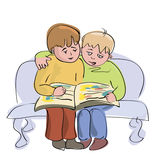 Two little boys reading one book Royalty Free Stock Image