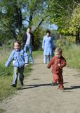 Two little boys running Royalty Free Stock Images