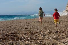Two little boys running on the beach Stock Images