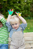 Two little boys showing their colored hands Stock Photography