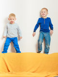 Two little boys siblings playing together Royalty Free Stock Images