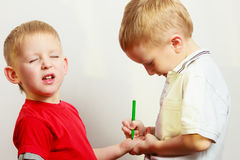 Two little boys siblings playing together Stock Photos