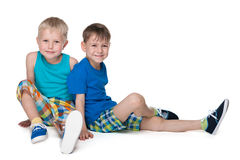 Two little boys sit together Royalty Free Stock Image