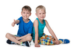 Two little boys sit together Royalty Free Stock Photos