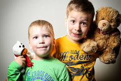 Two little boys with teddy bears Royalty Free Stock Photography