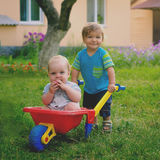 Two little boys toddler playing with colorful children& x27;s plastic Royalty Free Stock Photography