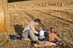 Two little boys and young father making evening picnic Stock Images