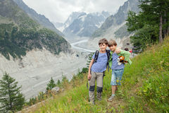 Two little brother to pose in front of the glacier Stock Photography