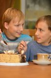 Two little brothers eat cake Royalty Free Stock Photo